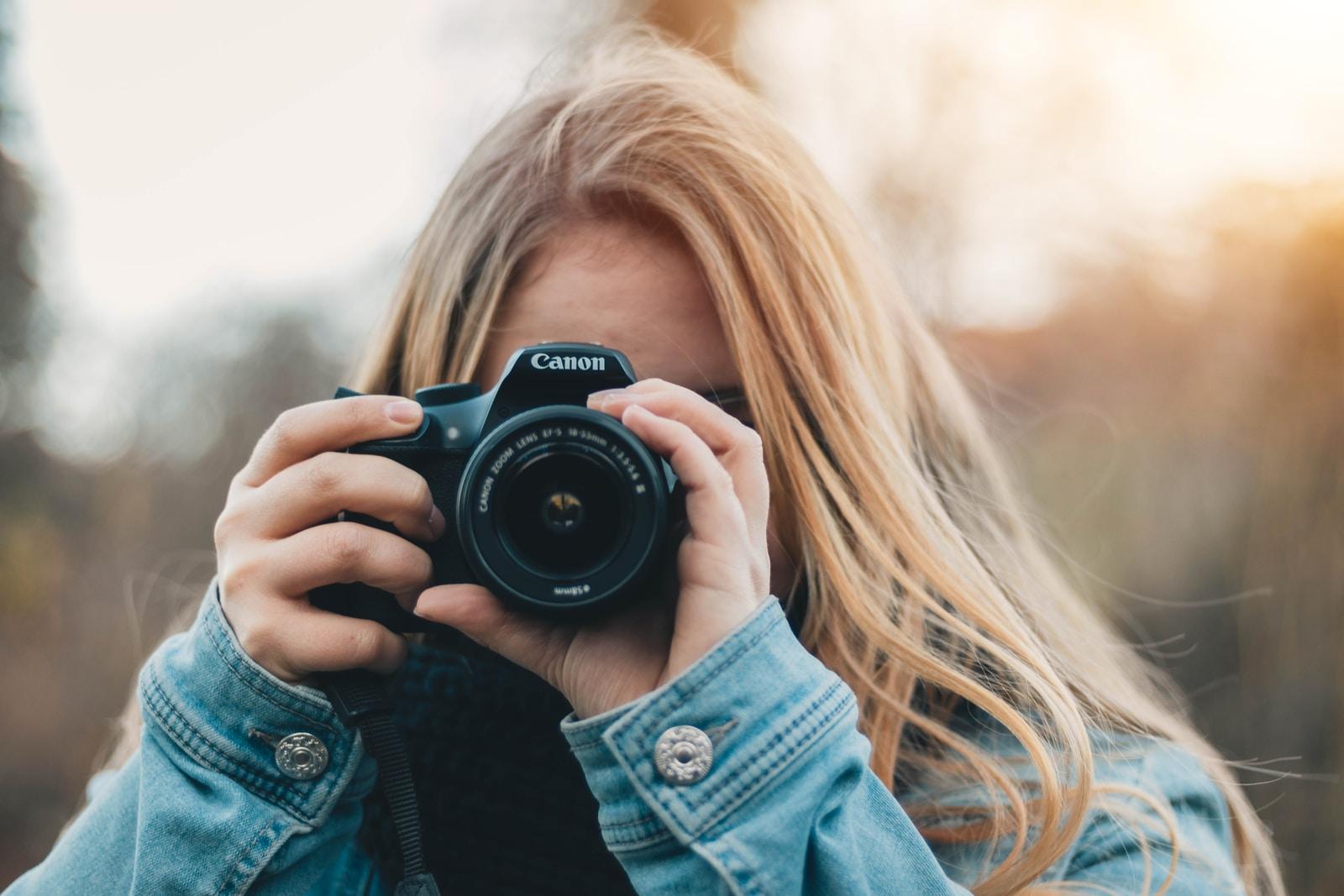 woman taking photo during daytime